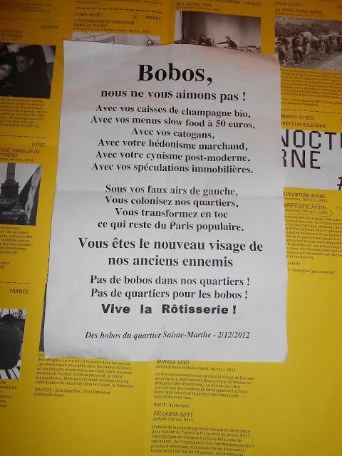 """Tract collé rue Sainte-Marthe (75010) et alentours: la Rôtisserie était un restaurant coopératif fréquenté par diverses sortes d'irréguliers (de l'antifascisme ou féminisme en passant par tous les """"sans""""), que les nouveaux arrivants du quartier ont réussi à faire fermer: on sait que ces gens aiment le Paris populaire seulement désinfecté et mis en scène dans leurs bistrots. Derrière, on aperçoit le programme d'un festival de films sur les révolutions arabes qui a lieu en ce moment à la faculté de Saint Denis: renseignez-vous, ce sera l'occasion d'aller là où se trouve le vrai coeur de Paris, c'est-à-dire en banlieue."""